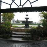View from front door looking under the canopy to the fountain.