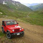Red Jeep in Green Mountains