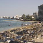 Beach with derelict hotels of Varosha evident