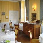 The breakfast room provides an elgant French country ambience.