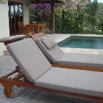 Plunge pool and deck chairs