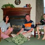 Our family around the room's fireplace