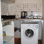 The mini-kitchen - includes washing-machine, fridge, microwave and 2 hot-plates