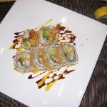 americandream roll,shrimp,eel,cucmber,and tempra flakes onthe outside