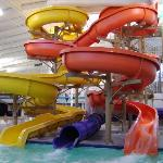 The three cool waterslides, onw which goes outside.