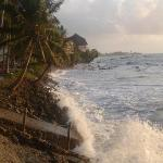 early morning high tide covering beach