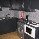 Kitchen w/ washer/dryer