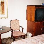 A view of the television, along with a table and chair