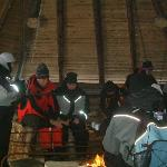 Ice fishing warm up by the fireside