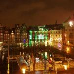 View at night - entrance to red light district is to right of the building with green lights