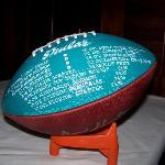 Menu is presented on a football signed by Don Shula