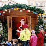 Santa looking after kids at Christmasmarket