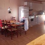 The kitchen - area with dining table for six