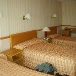 Room 213 - two twin beds and a single bed