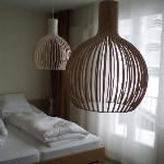 'Nature' room at Parkhotel Bellevue with maddening lampshades at shoulder height