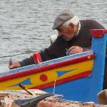 Boat maintenance in the village