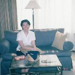 Mrs Deen seated on the sofa of our room
