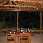 pergola over outdoor cooking and eating area