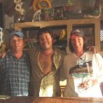 Me , Urwin (the bartender) , and my wife at the pool bar