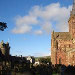 St Magnus from back of churchyard with Earl's Palace ruins to the left
