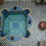 Looking down to the ground floor at the decorative plunge pool