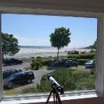 The view of Good Harbor Beach from Blue Shutters Inn in Gloucester