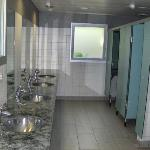 mens facilities. very clean. scrubbed every day. many available showers