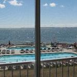 View from the balcony of pools, tiki bar, and Lake Erie