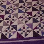 Purple quilt on display at the Latimer Quilt & Textile Center