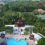 Pool, outdoor dining & tennis court with Mandalay Hill beyond