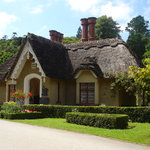 The thatched Deenagh Lodge gatehouse (coffee shop) in Knockreer Estate