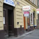 Entrance (under the blue hosiptal sign), mini market next to it.