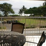 Large deck with seating for 4 overlooks Kamaole III beach from across the street...