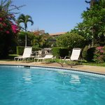 Great pool area with lots of flowers, palms, bbq area's, loungers...