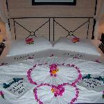 Our bed, decorated by the room boy