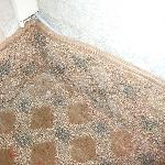 Carpet buckling from wall