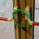 Detail of one of the bike locks securing the fire doors