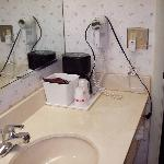 Bathroom Sink w/ coffeemaker & hair dryer