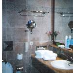 bathroom in porto sani village suite