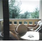 veranda in deluxe suite in porto sani village