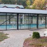 Enclosed heated pool for winter and volleyball