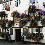 The pub across the street had even more flowers