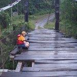 Chris sitting in the rain on the bridge waiting