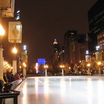 McCormick Tribune Ice Rink at night as the zamboni exits the rink