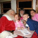 Santa with my kids (red-head and boy) and my neices