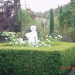 Statue at side of house