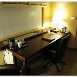 Great size work desk, but note the teeny coffee maker with paper cups