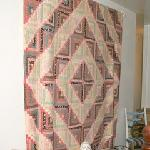 There are old quilts all over the place...