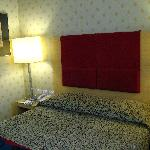 Room 408, bed in one of the rooms.