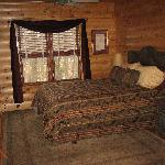 The comfortable bed in the Treetop Suite